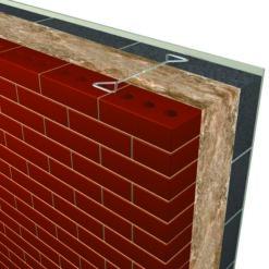 Knauf Earthwool Glasswoool Dritherm Cavity Wall Insulation installed behind bricks